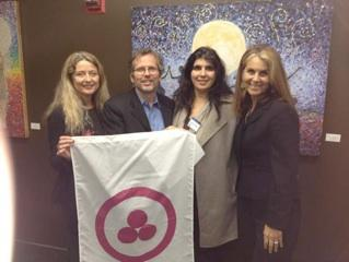 Rebecca Tobias, Phillip Hellmich, Sande Hart  with the Roerich Banner of Peace